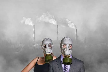 57101208-business-people-wearing-gas-mask-on-the-pollution-air-and-factory-background.jpg
